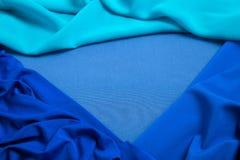 Dobleces del tejido triangular azul como fondo Fotografía de archivo libre de regalías