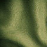 Dobleces ondulados del fondo del paño verde del extracto de la textura de la materia textil Fotos de archivo libres de regalías