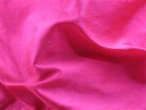 Dobleces que remolinan de la seda sin procesar rosada Imagen de archivo libre de regalías