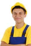 Doblez feliz del trabajador sus brazos y sonrisa Fotos de archivo