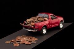 Dobra com moedas de um centavo Fotos de Stock Royalty Free
