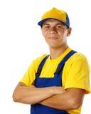 Dobra do trabalhador novo seus braços e sorriso Imagens de Stock