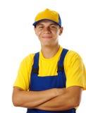 Dobra feliz do trabalhador novo seus braços e sorriso Fotografia de Stock Royalty Free