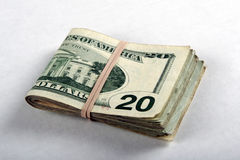 Dobrado vinte contas de dólar Imagens de Stock Royalty Free
