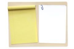 Dobrador de arquivo com bloco de notas e papel Fotografia de Stock