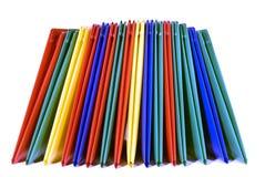 Dobradores brilhantemente coloridos empilhados Foto de Stock