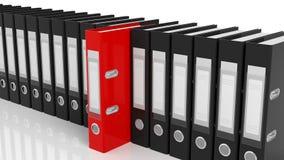 Dobradores vermelhos de um escritório entre o preto uns Imagens de Stock Royalty Free