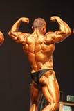 Dobramento do Bodybuilder Fotografia de Stock