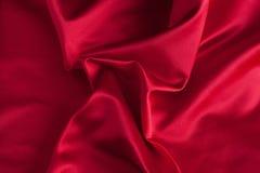 Dobras da tela de seda vermelha Fotos de Stock