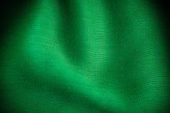 Dobras onduladas de pano verde do sumário do fundo da textura de matéria têxtil Fotos de Stock