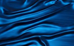Dobras onduladas do material azul de veludo do cetim da textura de seda do grunge ilustração do vetor