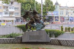 DOBRICH, BULGARIA, August 3 2015, City Park st. Georges monument. With busy street, cars and tourist royalty free stock photos