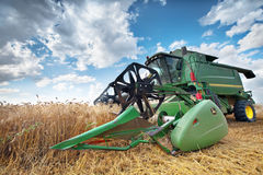 Dobrich, Bulgaria - July 08: Modern John Deere combine harvestin. G grain in the field near the town Dobrich, Bulgaria July 08, 2016 royalty free stock photo