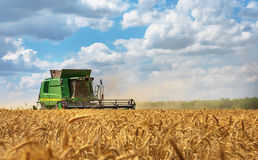 Dobrich, Bulgaria - July 08: Modern John Deere combine. Dobrich, Bulgaria - July 08: Modern John Deere combine harvesting grain in the field near the town stock photography