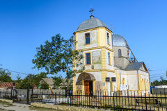 DOBROGEA, ROMANIA - 16 OCTOBER: Sfantu Gheorghe, the village's c. Hurch. Old church and simple buildings in a small city in Romania. Vertical view of a christian Royalty Free Stock Photo