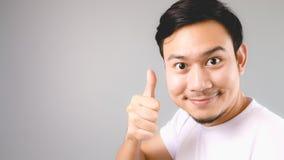 Dobry dla ciebie, twarzy i kciuka, up podpisuje Zdjęcie Stock