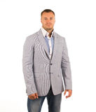 Dobry Przyglądający mężczyzna w szarości błękita i żakieta spodniach Obraz Royalty Free