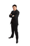 Dobry przyglądający młody biznesmen w ciemnym kostiumu zdjęcie stock