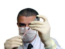 Doc filling a syringe stock images