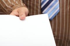 Doc.s blanc dans la main d'homme d'affaires image libre de droits