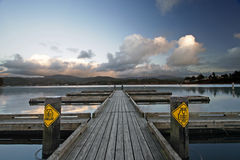 Doca do lago devil no por do sol Imagem de Stock