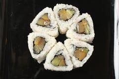 Doce ajustado um sushi com fruto, foto de stock