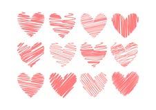 Doce corazones aislados en el fondo blanco Fotografía de archivo