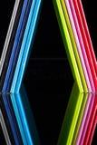 Doce diversos diarios y dólares de EE. UU. de los colores Imagen de archivo