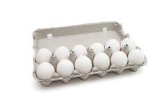 Doce huevos en un rectángulo de papel aislado Foto de archivo libre de regalías