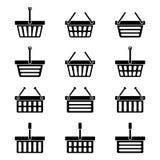 Doce siluetas de los iconos de las cestas de compras Foto de archivo libre de regalías