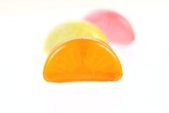 Doces alaranjados, amarelos e de açúcar Imagem de Stock Royalty Free