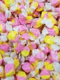 Doces amarelos e cor-de-rosa Imagem de Stock