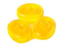 Doces amarelos isolados em um fundo branco Fotografia de Stock Royalty Free