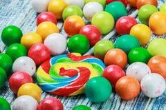 Doces coloridos e pastilha elástica Imagens de Stock
