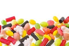 Doces coloridos isolados no branco Fotos de Stock