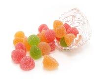 Doces da fruta da cor em um vaso de cristal Fotografia de Stock Royalty Free