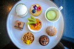 Doces da sobremesa do lanche e da pastelaria ajustados Foto de Stock