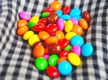 Doces de chocolate coloridos Fotos de Stock