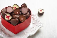 Doces de chocolate da forma do coração Imagens de Stock Royalty Free