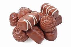 Doces de chocolate em um fundo branco fotografia de stock