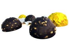 Doces de chocolate na folha Imagem de Stock Royalty Free