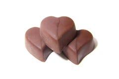 Doces de chocolate três na forma do coração imagens de stock