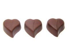 Doces de chocolate três na forma do coração imagem de stock royalty free