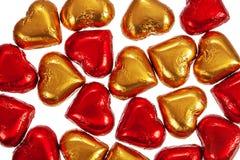 Doces de chocolate vermelhos e amarelos no branco Imagens de Stock Royalty Free