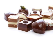 Doces de chocolates sortidos para a sobremesa imagem de stock royalty free