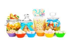 Doces diferentes nos frascos e nos formulários de vidro Fotografia de Stock