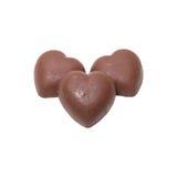 Doces do coração de três chocolates no fundo branco Foto de Stock Royalty Free