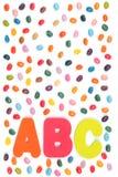 Doces do feijão de geleia e letras de ABC imagem de stock royalty free