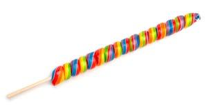 Doces do Lollipop do Twirl do arco-íris fotos de stock royalty free