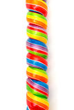 Doces do Lollipop do Twirl do arco-íris imagem de stock